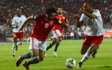 Egypt's Mohamed Salah vies for the ball against Congo's Tobias Badila during their World Cup 2018 Africa qualifying match between Egypt and Congo at the Borg el-Arab stadium in Alexandria on 8 October, 2017. Picture: AFP.
