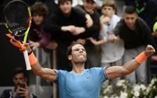 Rafael Nadal of Spain celebrates after winning against Greece's Stefanos Tsitsipas during their ATP Masters tournament semi-final tennis match at the Foro Italico camp in Rome, on 18 May 2019. Picture: AFP