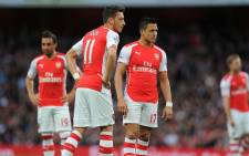 Alexis Sanchez and Mesut Ozil of Arsenal stare in despair after their loss to Swansea City in the English Premier League at the Emirates on 11 May 2015. Picture: Arsenal official Facebook page.