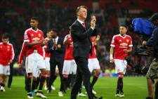 Manchester United manager Louis van Gaal and his players during a lap of honour after a game against Bournemouth on 17 May 2016. Picture: Manchester United official Facebook page.