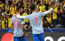 Manchester United's Bruno Fernandes and Cristiano Ronaldo celebrate a goal in their UEFA Champions League match against Young Boys on 14 September 2021. Picture: @ChampionsLeague/Twitter