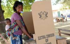 A woman votes at Maluwe polling station, Bole Bamboi constituency, in a northern region on December 7, 2012 as Ghana voted in a high-stakes presidential election. Picture: AFP/ PIUS UTOMI EKPEI