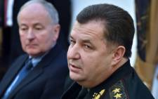 Ukrainian Defence Minister Stepan Poltorak (R) speaks next to Canada's Minister of National Defence Rob Nicholson during a press conference following talks in Kiev on 8 December, 2014. Picture: AFP.