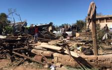 Residents in Zandspruit clean up a day after a severe storm in the area on 9 October 2017. Picture: Christa Eybers/EWN