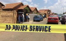 Forensic pathologists on scene where the remains of Palesa Madiba were found in a shallow grave at a friend's home in Soweto in December 2015. Picture: EWN.