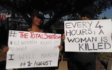 FILE: Women holding placards in support of the #TotalShutDown movement. Picture: @WomenProtestSA/Facebook.com