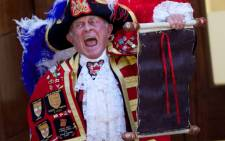 A town crier announces the birth of the royal baby. Picture: AFP.