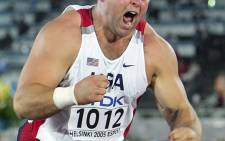 US Adam Nelson celebrates after winning the gold medal during the men's shot put finals at the 10th IAAF World Athletics Championships in Helsinki 06 August 2005. Picture: AFP/ADRIAN DENNIS