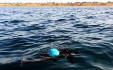 FILE. The body of an illegal immigrant floats on the water after a boat carrying illegal migrants from sub-Saharan Africa sank. Picture: AFP.