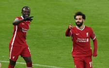 Liverpool's Sadio Mane and Mohamed Salah celebrate a goal against Leipzig on 10 March 2021. Picture: @LFC/Twitter.