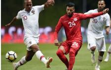 Tunisia's forward Anice Badri (R) challenges Portugal's midfielder Joao Mario during an international friendly football match between Portugal and Tunisia at the Municipal Stadium in Braga on 28 May, 2018. Picture: AFP