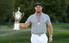 Bryson DeChambeau of the United States celebrates with the championship trophy after winning the 120th US Open Championship on 20 September 2020 at Winged Foot Golf Club in Mamaroneck, New York. Picture: AFP