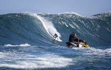 A surfer glides down the face of one of the massive waves Dungeons served up on 24 August 2016. Picture: Aletta Harrison/EWN.