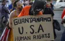 A man demonstrates against the US Guantanamo prison ahead of the Peoples Summit to be held in parallel with the VII Americas Summit, in Panama City on 9 April, 2015. Picture: AFP.