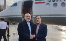 Iran's Foreign Minister Mohammad Javad Zarif (L) with Iranian scientist Massoud Soleimani (R) who was released in an apparent prisoner swap with the United States on 7 December 2019. Picture: @JZarif/Twitter.