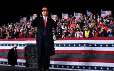 FILE: Former US president Donald Trump at a rally at Southern Wisconsin Regional Airport in Janesville, Wisconsin on 17 October 2020. Picture: AFP