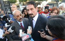 Anti-virus software guru John McAfee in front of the Supreme Court in Guatemala City on 4 December 2012. Picture: AFP/Johan Ordonez