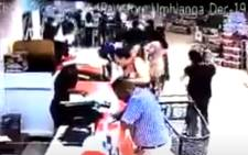A video screengrab of a man taking the child from a trolley at a shopping mall in Umhlanga, Durban.