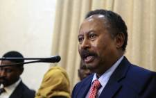FILE: Abdalla Hamdok speaks after being sworn in as Sudan's interim prime minister in the capital Khartoum on 21 August 2019.  Picture: AFP