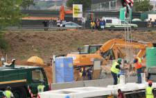 A Murray Roberts sign is seen at the scene where a temporary pedestrian bridge collapsed on the M1 in Sandton. Picture: Christa Eybers/EWN.