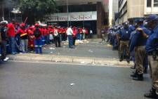 Police stand off with striking Pikitup members in Braamfontein. Picture:Kgothatso Mogale/EWN.