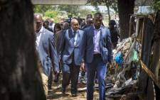 President Jacob Zuma inspects Setjwetla, an the area of Alexandra that was flooded and where one person subsequently lost their life.  Picture: Thomas Holder/EWN