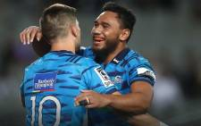Blues' Otere Black (L) celebrates his try with teammate TJ Faiane (R) during their Super Rugby match against Stormers at Eden Park in Auckland. Picture: @ theblues/Facebook.com.