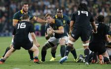 FILE: South African loose forward Duane Vermeulen tries to break through during the final phase of the Four Nations tournament rugby union match between South Africa and New Zealand. Picture: AFP.