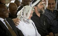 Barbara Hogan, widow of Ahmed Kathrada, is comforted during the anti-apartheid activist's funeral at Westpark cemetery in Johannesburg on 29 March 2017. Picture: Reinart Toerien/EWN