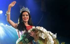 Trixie Maristela of Philippines waves after being crowned Miss International Queen 2015 beauty contest in Pattaya, on 6 November, 2015. Picture: AFP.
