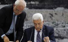 Palestinian president Mahmoud Abbas signs a request to join 15 United Nations agencies at his headquarters in the West Bank city of Ramallah on 1 April. Picture: AFP.