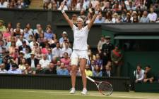 Petra Kvitova raises her hands in delight after winning her Second Wimbledon crown. Picture: Facebook.