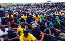 Amcu members listen to Joseph Mathunjwa ahead of the union's strike on the platinum belt on 23 January 2014. Picture: Vumani Mkhize/EWN.
