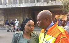 Johannesburg mayor Herman Mashaba with the mother of the 13-year-old girl who was kidnapped and believed to be inside the hijacked building. Picture: Twitter/@HermanMashaba.