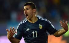 Argentina's forward Sergio Aguero celebrates after scoring against Uruguay during their 2015 Copa America football championship match, in La Serena, Chile, on 16 June, 2015. Picture: AFP.