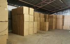 Boxes of unprocessed tobacco were found at a warehouse in East London on 21 July 2021. A suspect was arrested by the police. Picture: @SAPoliceService/Twitter