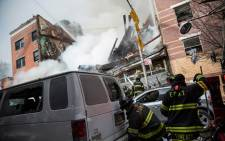 Firefighters from the Fire Department of New York (FDNY) respond to a 5-alarm fire and building collapse at 1646 Park Ave in the Harlem neighborhood of Manhattan March 12, 2014 in New York City. Reports of an explosion were heard before the collapse of two multiple-dwelling buildings that left at least 11 injured. Picture: AFP.