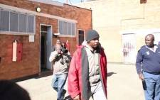 Former Jozi FM DJ Donald Sebolai arriving at Jabulani Police Station. Picture: 'Daily Sun' You Tube video.