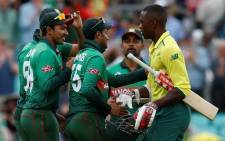 Bangladesh's Shakib Al Hasan (C) shakes hands with South Africa's Kagiso Rabada (R) as he and his teammates celebrate after victory over South Africa by 21 runs after the 2019 Cricket World Cup group stage match between South Africa and Bangladesh at The Oval in London on 2 June 2019. Picture: AFP