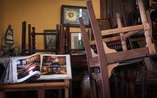 Chairs remain upside down at the closed La Guarida restaurant in Havana on 16 March 2020, amid the new coronavirus pandemic. With American convertible cars in their garages and closed bars and restaurants, Havana is a dead city. Picture: AFP