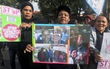 FILE: Wellington community members protest outside the magistrates court where murder accused Johan Williams made an appearance on 13 July 2018. Picture: Shamiela Fisher/EWN