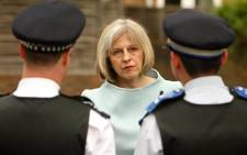 UK Home Secretary, Theresa May, pictured here talking to a neighbourhood policing team.