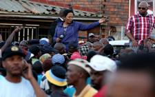 Gauteng Premier Nomvula Mokonyane visited the troubled area in an attempt to calm protesting resident in Bekkersdal. Residents continued to protest and burn tyres during her address. Picture: Sebabatso Mosamo/EWN