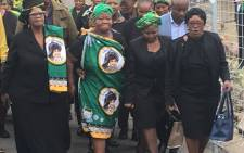 Stompie Seipei's mother Joyce Seipei (C) walks towards late struggle stalwart Winnie Madikizela-Mandela's home on 10 April 2018. Picture: Hitekani Magwedze/EWN