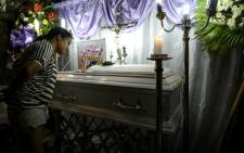A relative views the casket of three-year-old Kateleen Myca Ulpina, killed during a sting operation conducted by the police, is seen during her wake in Rodriguez, Rizal, east of Manila on 5 July, 2019. Picture: AFP