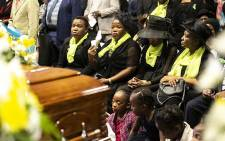 The family of Thoriso Themane look on after his casket is brought into the hall at his funeral. Picture: Kayleen Morgan/EWN