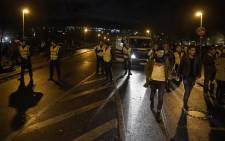 Police secures the area as supporters leave the stadium after the friendly football match Germany vs the Netherlands was called off for 'security reasons' in Barsinghausen on November 17, 2015. Picture: AFP.