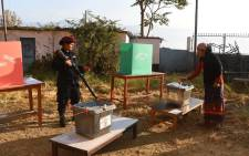 A Nepali woman casts her vote at a polling station during the general election at Chautara, Sindhupalchowk district on 26 November 2017. Picture: AFP.