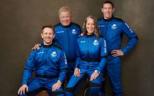 This handout photo released by Blue Origin Media shows the four-member Blue Origin crew (from R) Glen de Vries, Audrey Powers, Canadian actor William Shatner and Chris Boshuizen posing at an undisclosed location on 10 October 2021. Picture: BLUE ORIGIN/AFP