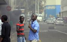 FILE: Clashes broke out between a group of locals and police in Durban on 14 April 2015 in ongoing violence against foreign nationals in Durban. Picture: AFP.